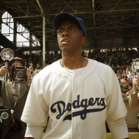 "Actor Chadwick Boseman portrays legenday baseball player Jackie Robinson in the new Warner Bros. film ""42' in this undated publicity photograph"